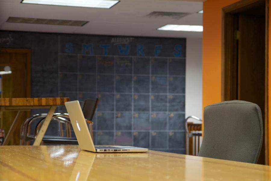 computer on desk at appleton coworking