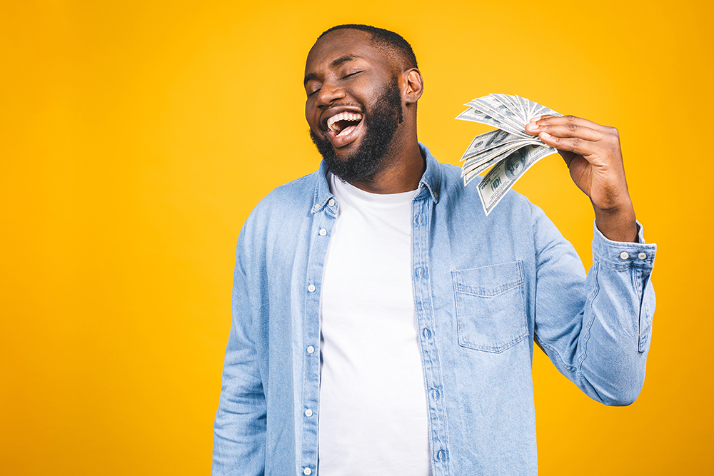guy holding money from personal loan