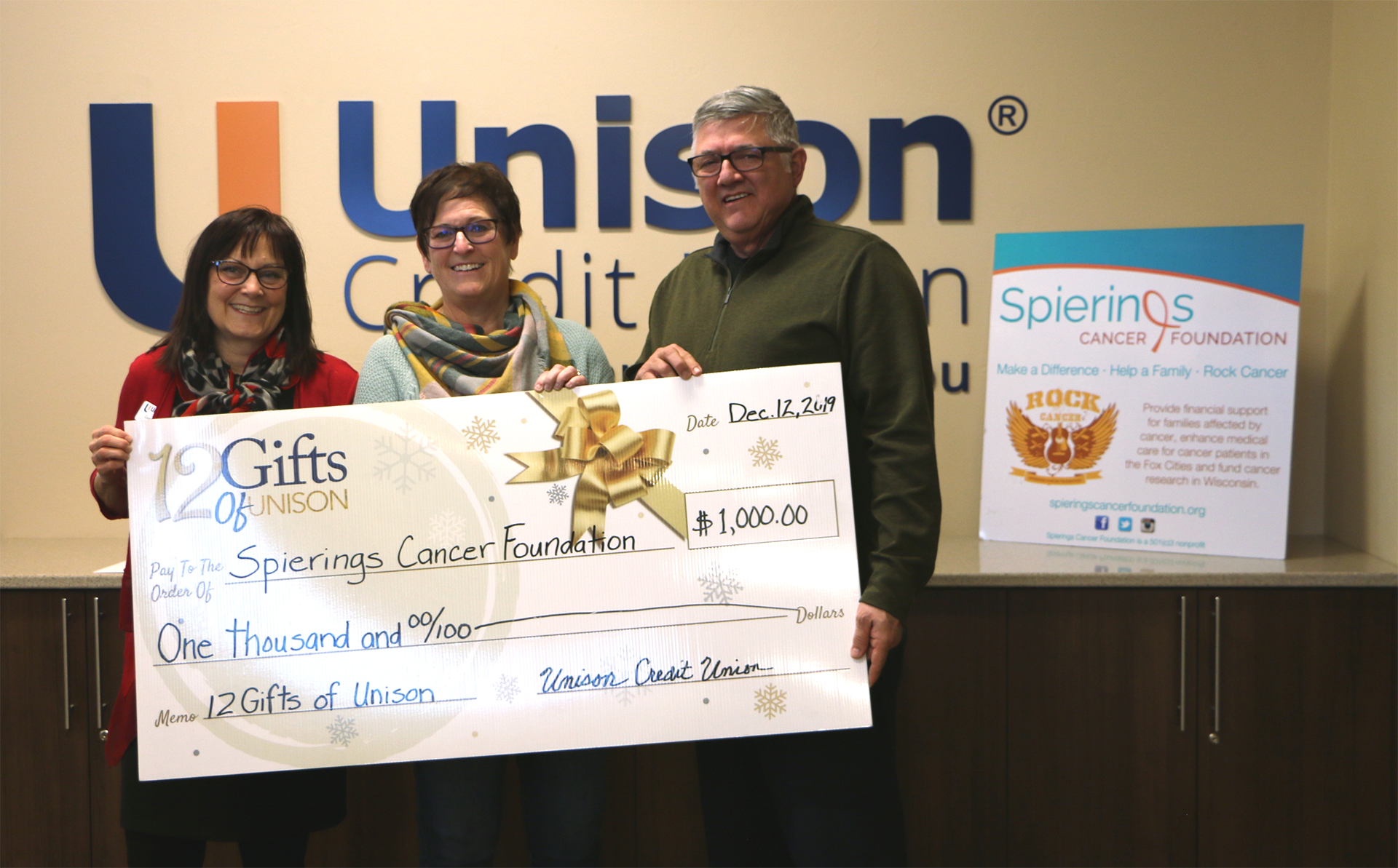 spierings getting donation check from unison
