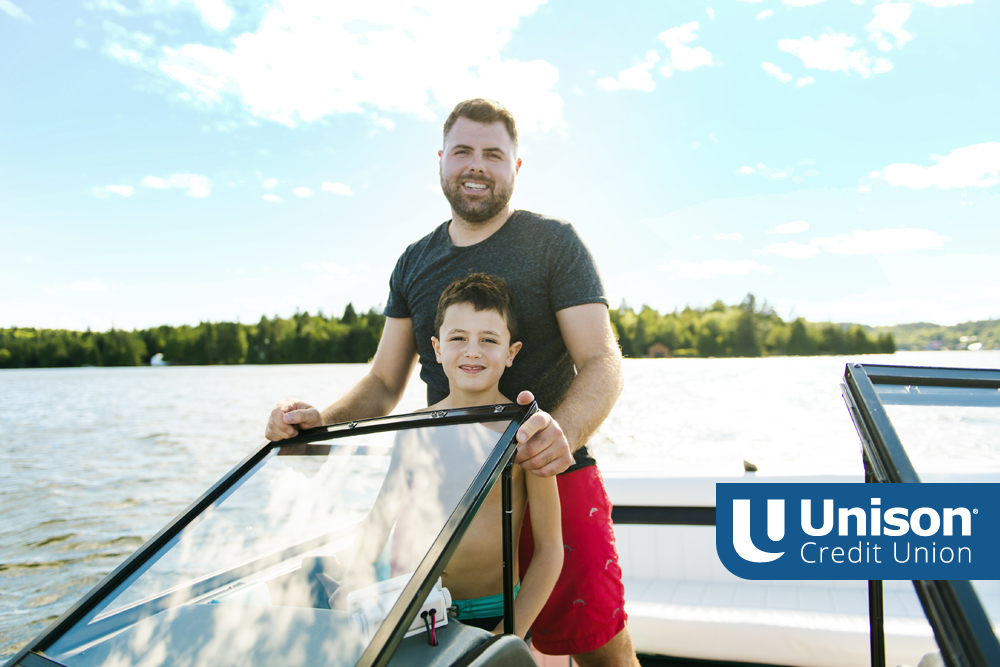 father and son on a boat in wisconsin